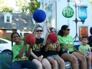 Showing off a Water Molecule on the Library Float for the 4th of July - the theme is Fizz Boom Read!