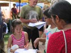 Young people sign a letter to Maryland legislators demanding clean energy.