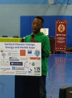 Zion speaks about a solar powered car at the Harford County Climate Expo, Edgewood Boys and Girls Club